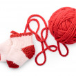 Isolated red skein and knitted socks - Foto Stock