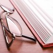 Glasses and open book — Stock Photo