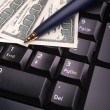 Keyboard,money and pen — Stock Photo