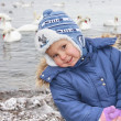 Stock Photo: The child in winter clothes against the sea