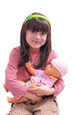 Smiling girl with doll — Stock Photo