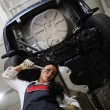 Pretty young girl in repair center — Stock Photo