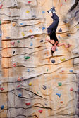 Young woman on rock wall — Stock Photo