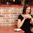 Stock Photo: Girl with cup of coffee