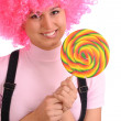 Teenager hold round lollipop — Stock Photo