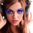 Sexy woman with fashion make-up listen music — Stock Photo