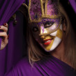 Smiling woman in violet mask — Stock Photo #4966429