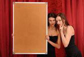 Girl hold empty board — Stock Photo