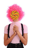 Funny teenager with round lollipops — Stock Photo