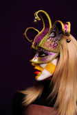 Woman in violet half mask — Photo