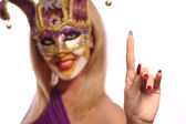Smiling woman in violet mask — Stock Photo