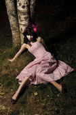 Girl lie near tree — Stock Photo