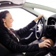 Beauty young businesswoman drive the car — Stock Photo