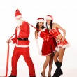 Santa Claus pull two girls — Stock Photo