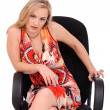 Evil woman sitting in armchair — Stock Photo