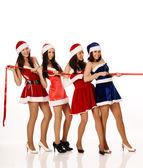 Four girls pull ribbon — Stock Photo