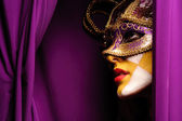Woman in violet mask — Stock Photo