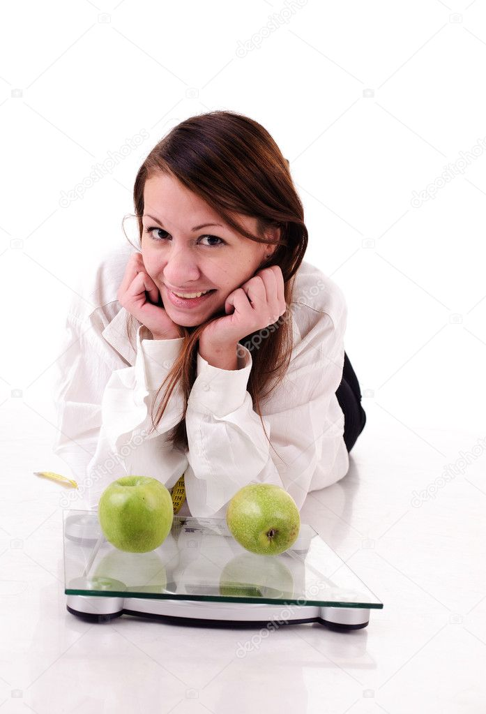 Pretty woman and two green apples on scales, isolated on white — Stock Photo #5118935