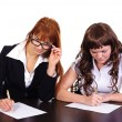Stock Photo: Two business women working together