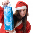 Santa Claus with a gift — Stock Photo