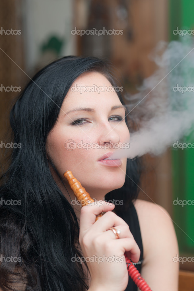 Portrait of the girl smoking a hookah  Stock Photo #4879321