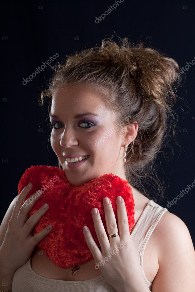 Portrait of the girl with a red heart — Stock Photo #5282637