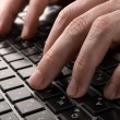 Hands on keyboard of computer — Stockfoto