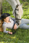 Young woman with her horse — Stock Photo