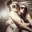 Two fashion sexy women wearing sunglasses — Stock Photo