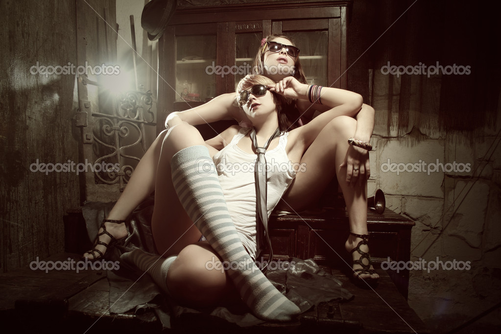 Two fashion sexy women  wearing sunglasses   Stock Photo #5123723
