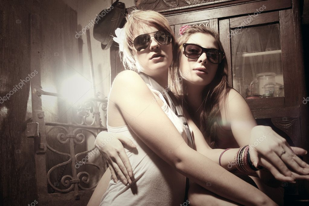 Two fashion sexy women  wearing sunglasses   Stock Photo #5123747