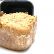 Crusty whole-grain bread out of the bread machine — Stock Photo