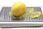 Potato rasping — Stock Photo