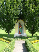 Holy statue as place for praying for christians in Freiland Austria — Stock Photo