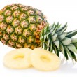 Ripe pineapple with slices isolated — Stock Photo #4955278