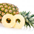 Stock Photo: Ripe pineapple with slices isolated
