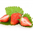 Red sliced strawberry fruits with green leaves — Stock Photo #4962149