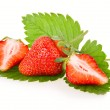 Red sliced strawberry fruits with green leaves — Stock Photo #4962154