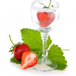 Strawberry fruits with green leaves in glass — Stock Photo