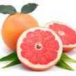 Stock Photo: Grapefruit fruits with cuts and green leaf isolated