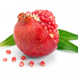 Pomegranate fruit with green leaf and cuts isolated — Stock Photo #4967852