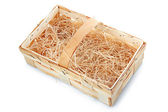 Empty wooden basket with straw isolated — Stock Photo