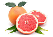 Grapefruit fruits with cuts and green leaf isolated — Stock Photo