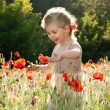 Little girl on the poppy field — Stock Photo #4540830
