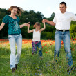 Running Family on the poppy field — Stock Photo