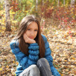 Stock Photo: Teenager girl in autumn forest