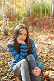 Teenager girl in the autumn forest — Stock Photo