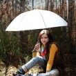 Brunette girl under light umbrella — Stock Photo #4167762