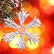 Snowflake on branch of Christmas tree — Stock Photo