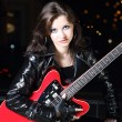 Brunettte guitar player girl — Stock Photo #4223281